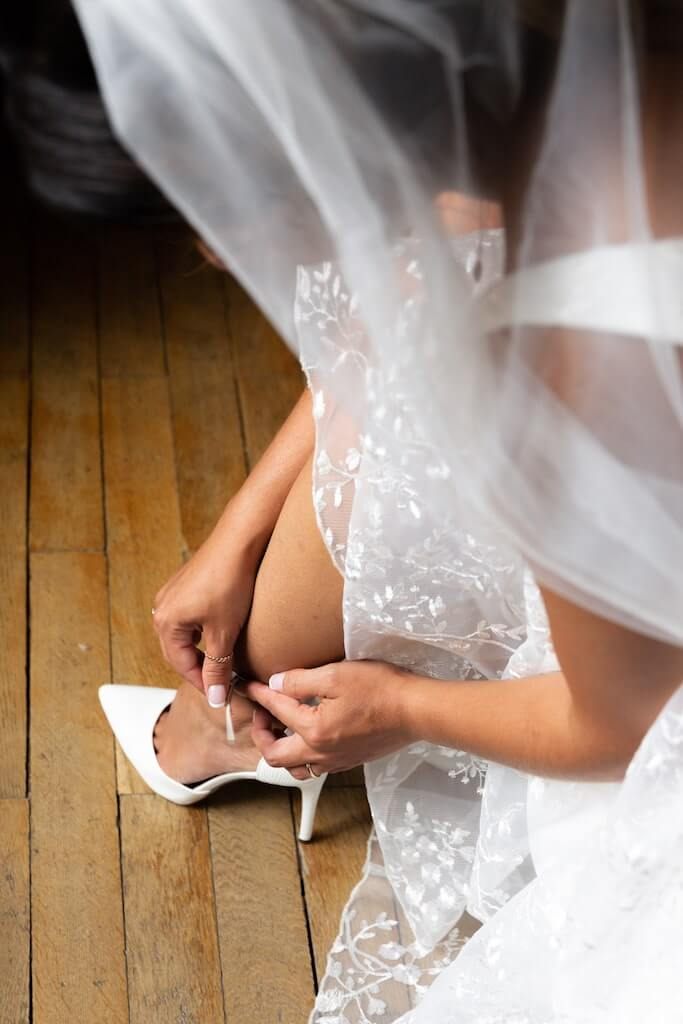 Bride putting on her shoes in Tuscany
