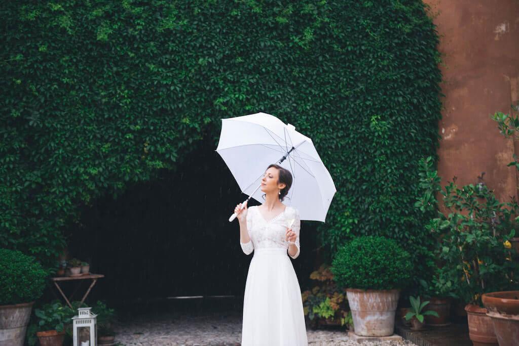 Bride with a white umbrella